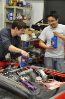 Marc and Keen work on the Boost Logic race car