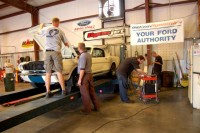 A white '65 Mustang on the dyno